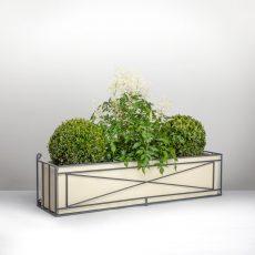 Ironwork window box with plants