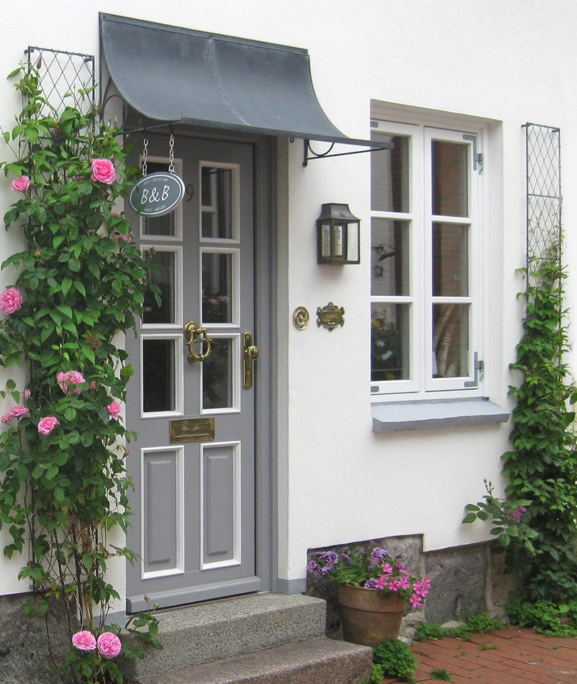 over door porches door canopy designs metal planters. Black Bedroom Furniture Sets. Home Design Ideas