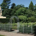 Arch with gates and latticework trellis and posts