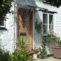 Bespoke porch with decorative filigree