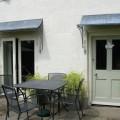 Door canopies with curving trellis brackets
