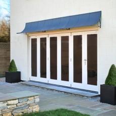 Door canopy over bifold doors in grey