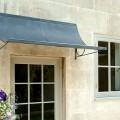 Door canopy in zinc finish