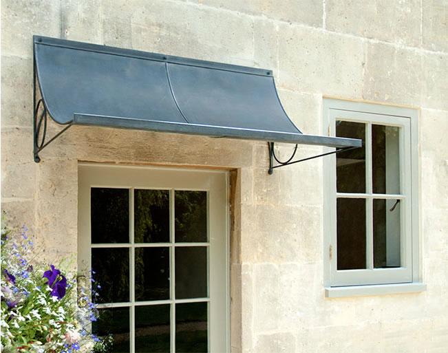 Over door porches door canopy designs metal planters for Window trellis design